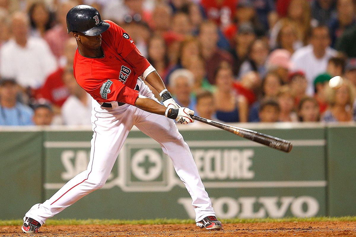 BOSTON, MA:  Pedro Ciriaco #77 of the Boston Red Sox hits a double to knock in two runs in the seventh in Boston, Massachusetts.  (Photo by Jim Rogash/Getty Images)
