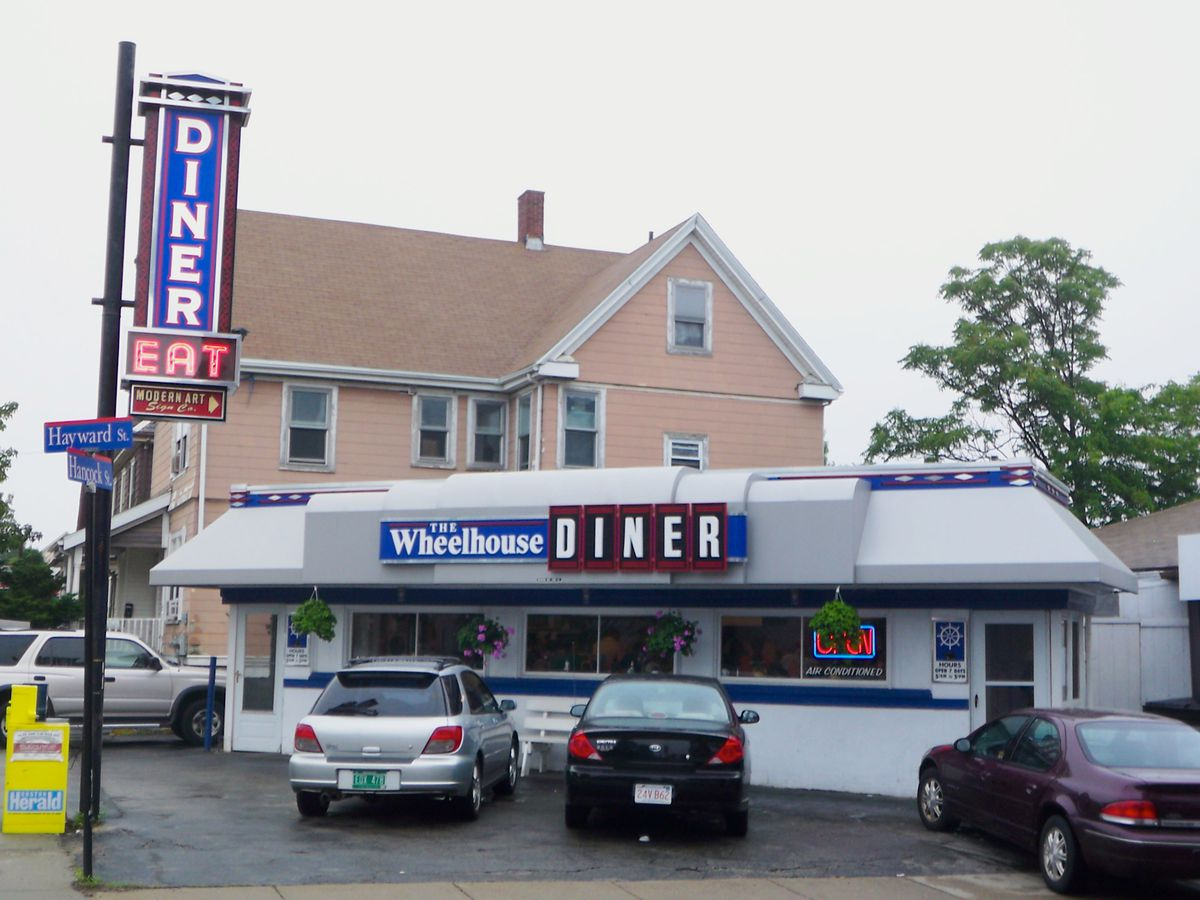 """Exterior of a diner with bold blue and red signage reading """"Wheelhouse"""""""