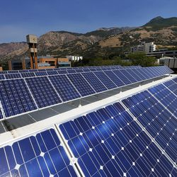Solar panels on the roof of the Shepherd Union Building at Weber State University in Ogden gather energy on Friday, Aug. 19, 2016. At back left is the new energy saving Tracy Hall Science Center.