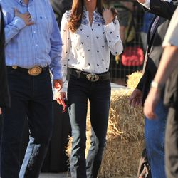 Wearing Goldsign jeans paired with a printed Temperley blouse to watch the traditional Calgary Stampede in Canada on July 7th, 2011.