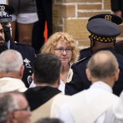 Chicago Police Supt. David Brown speaks with Elizabeth French, mother of Officer Ella French, as he gives her the flag that draped her daughter's casket after Officer French's funeral at St. Rita of Cascia Shrine Chapel, Thursday, Aug. 19, 2021. French was fatally shot and her partner was critically wounded while in the line of duty on Aug. 7 in West Englewood.