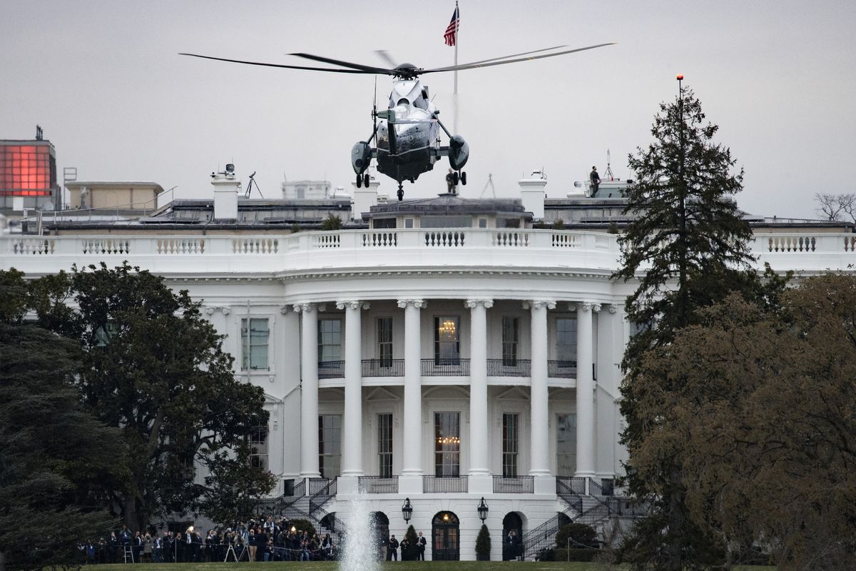 Marine One helicopter landing in front of the White House.