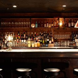No need to get drinks upstairs. The lounge has a full bar.