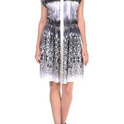 "<a href=""http://www.icbnyc.com/shop/midnight-multi-melting-lace-print-silk-dress-with-lace-yoke"">Melting lace print silk dress</a>, $69.00 (was $465.00)"