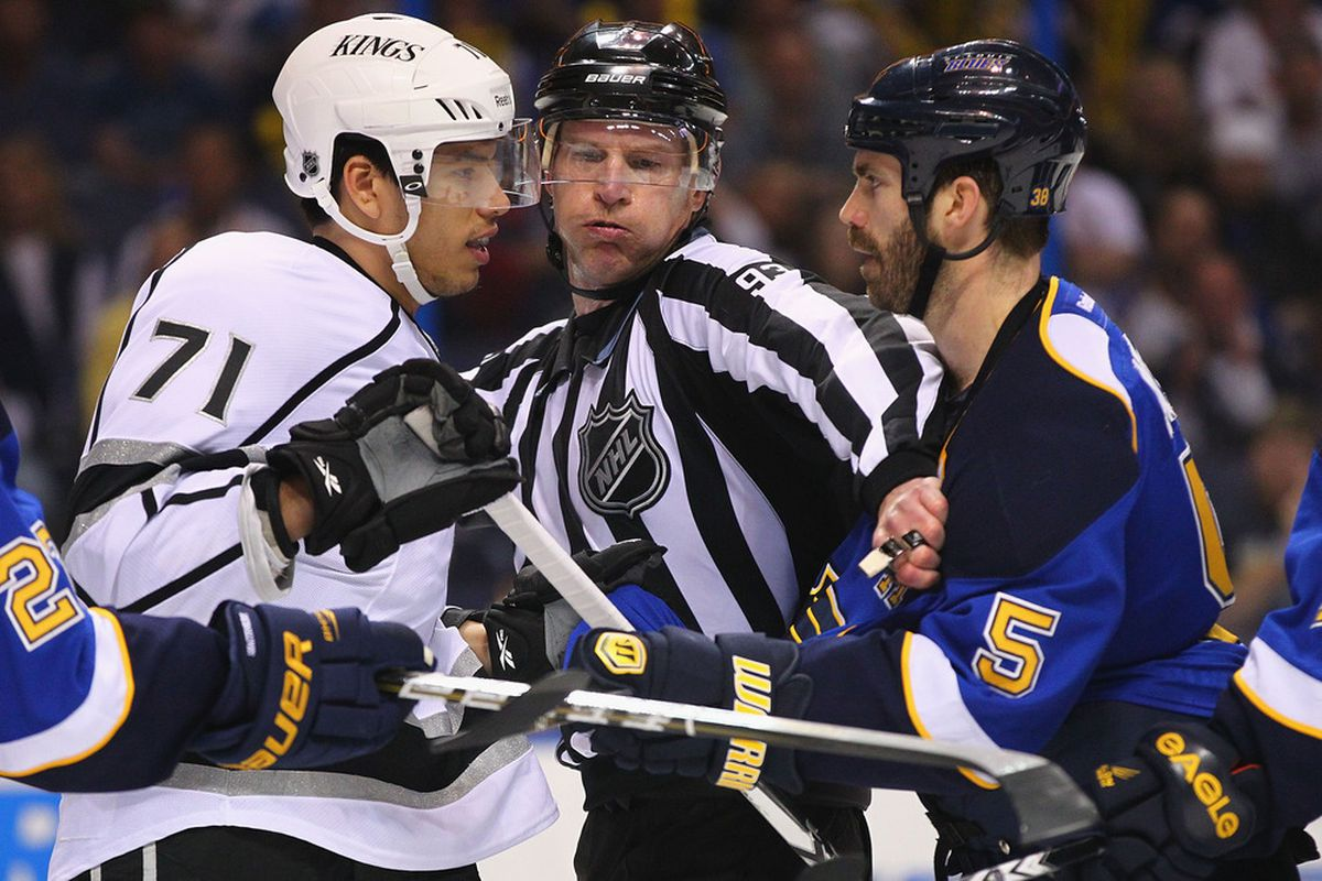 The linesman is holding his breath trying not to smell Jackman.