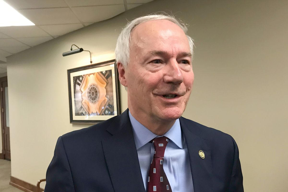 In this Jan. 13, 2020, file photo, Arkansas Gov. Asa Hutchinson speaks to reporters in Little Rock, Ark.