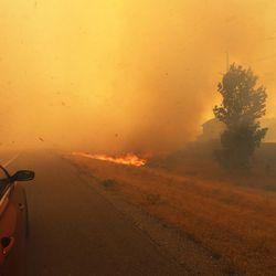 Fire burns along I-84 near Weber Canyon on Tuesday, Sept. 5, 2017.