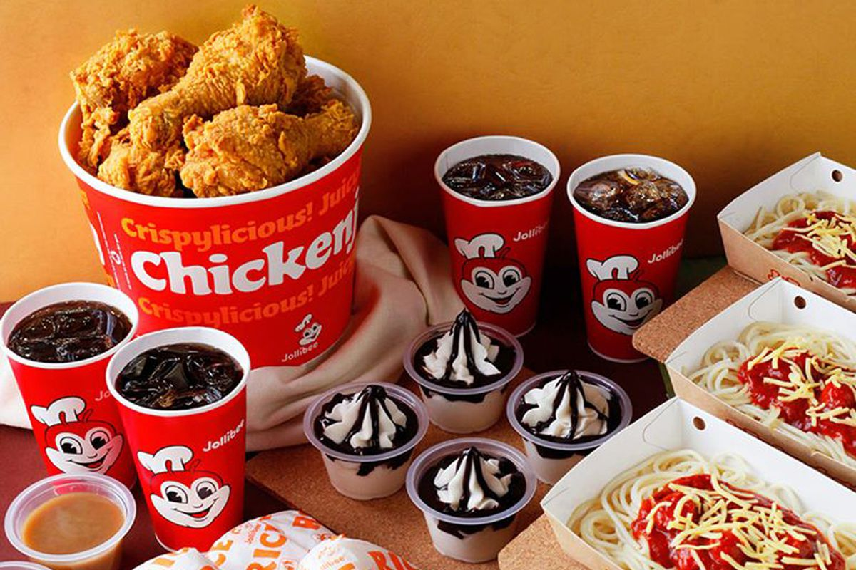 """A Jollibee """"Chickenjoy"""" bucket meal, including rice, sides, spaghetti and sundaes."""