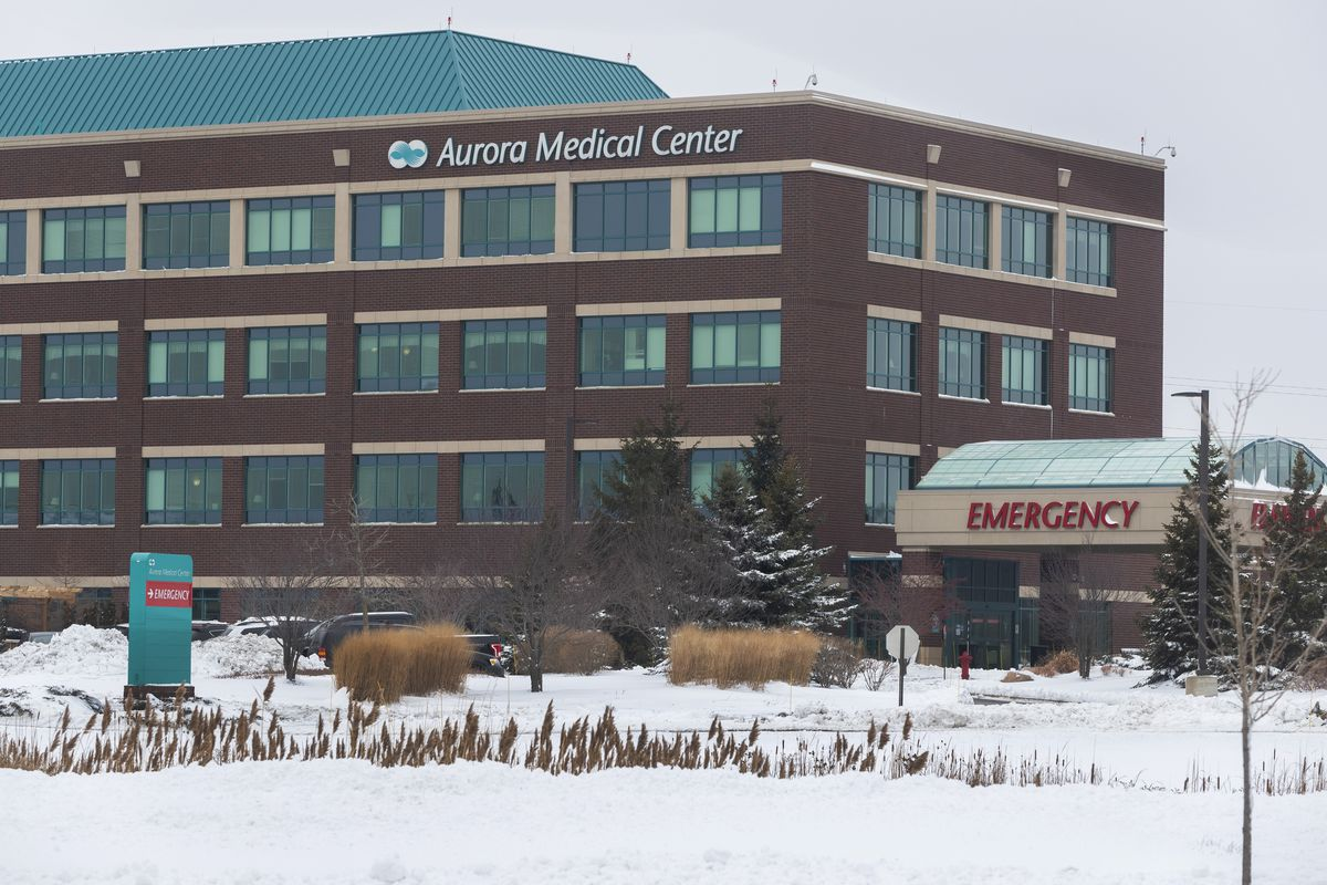 This Thursday, Dec. 31, 2020 photo shows the Aurora Medical Center in Grafton, Wis. A pharmacist at the suburban Milwaukee medical center deliberately removed hundreds of coronavirus vaccine doses from refrigeration and left them out overnight twice, not just once as officials initially believed, the health system's chief medical officer said Thursday.