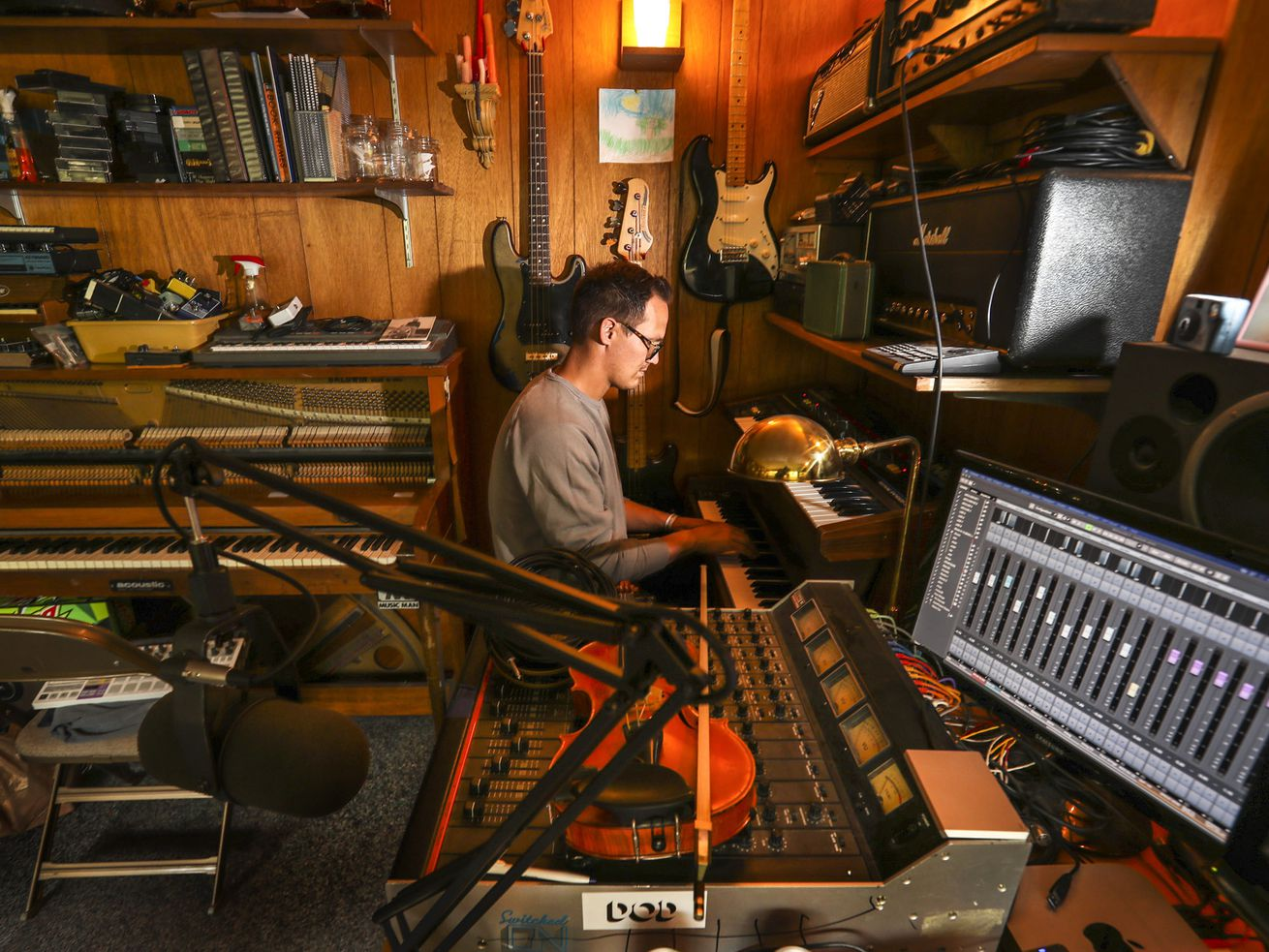 """Musician Stuart Maxfield plays a keyboard in his home studio in Springville on Thursday, Sept. 10, 2020. Maxfield released his disco-inspired solo album """"Shun the Yuck"""" the same day Utah Governor Gary Herbert declared a state of emergency because of COVID-19."""