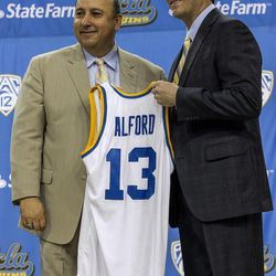 FILE -- Dan Guerrero, left, UCLA athletic director, introduces Steve Alford as men's basketball coach during a news conference at Pauley Pavilion in Los Angeles on Tuesday, April 2, 2013. Alford was hired Saturday, spurning New Mexico days after he agreed to a new 10-year deal with the Lobos.