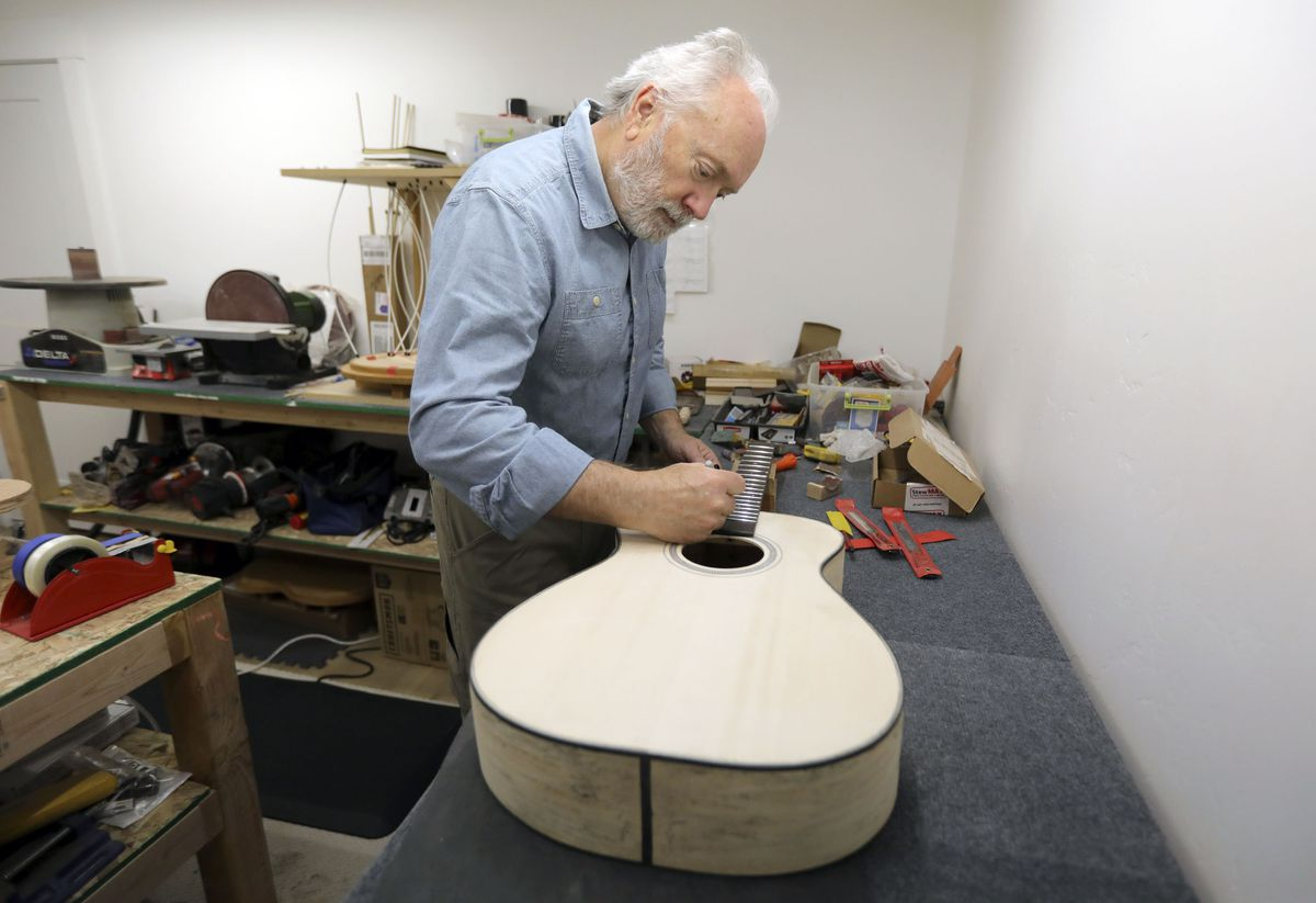 Steve Allen builds a guitar for his business, Northern Light Guitars, at his home in Heber City on Thursday, May 6, 2021.