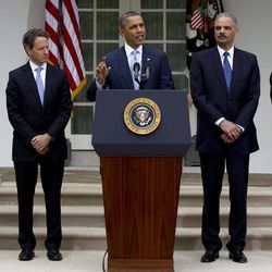 President Barack Obama speaks in the Rose Garden of the White House in Washington, Tuesday, April 17, 2012, about a plan to increase oversight and crack down on manipulation in oil markets. From left are, FTC Chairman Jon Leibowitz, Treasury Secretary Timothy Geithner, the president, Attorney General Eric Holder, and Commodity Futures Trading Commission (CFTC) Chairman Gary Gensler.