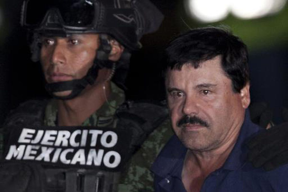 """Mexican drug lord Joaquin """"El Chapo"""" Guzman is escorted by soldiers and marines to a helicopter Jan. 8, 2016, in Mexico City after his arrest."""
