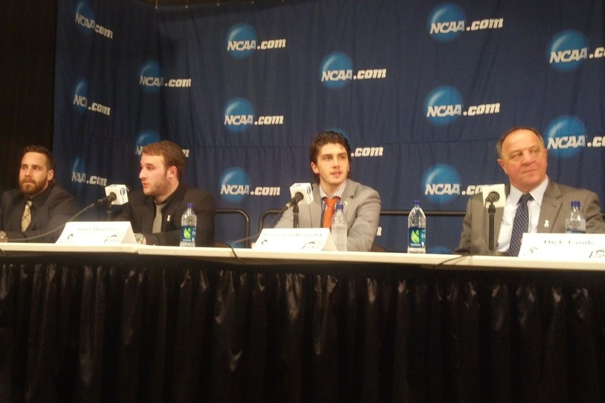Austin Block, John Henrion, Trevor van Riemsdyk and Dick Umile of UNH following the Wildcats 5-2 victory over Denver in the NCAA Northeast Regional
