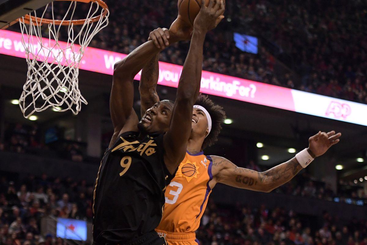 Phoenix Suns forward Kelly Oubre Jr. fouls Toronto Raptors forward Serge Ibaka in the first half at Scotiabank Arena.
