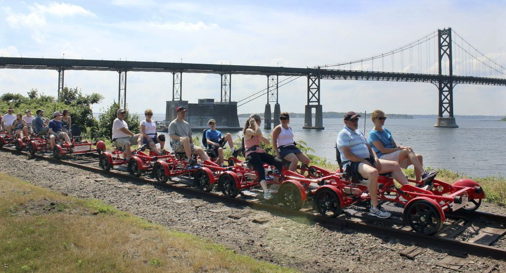 A Rail Explorers tour stops to admire the view by the Mount Hope Bridge in Portsmouth, R.I | (AP Photo/Jennifer McDermott