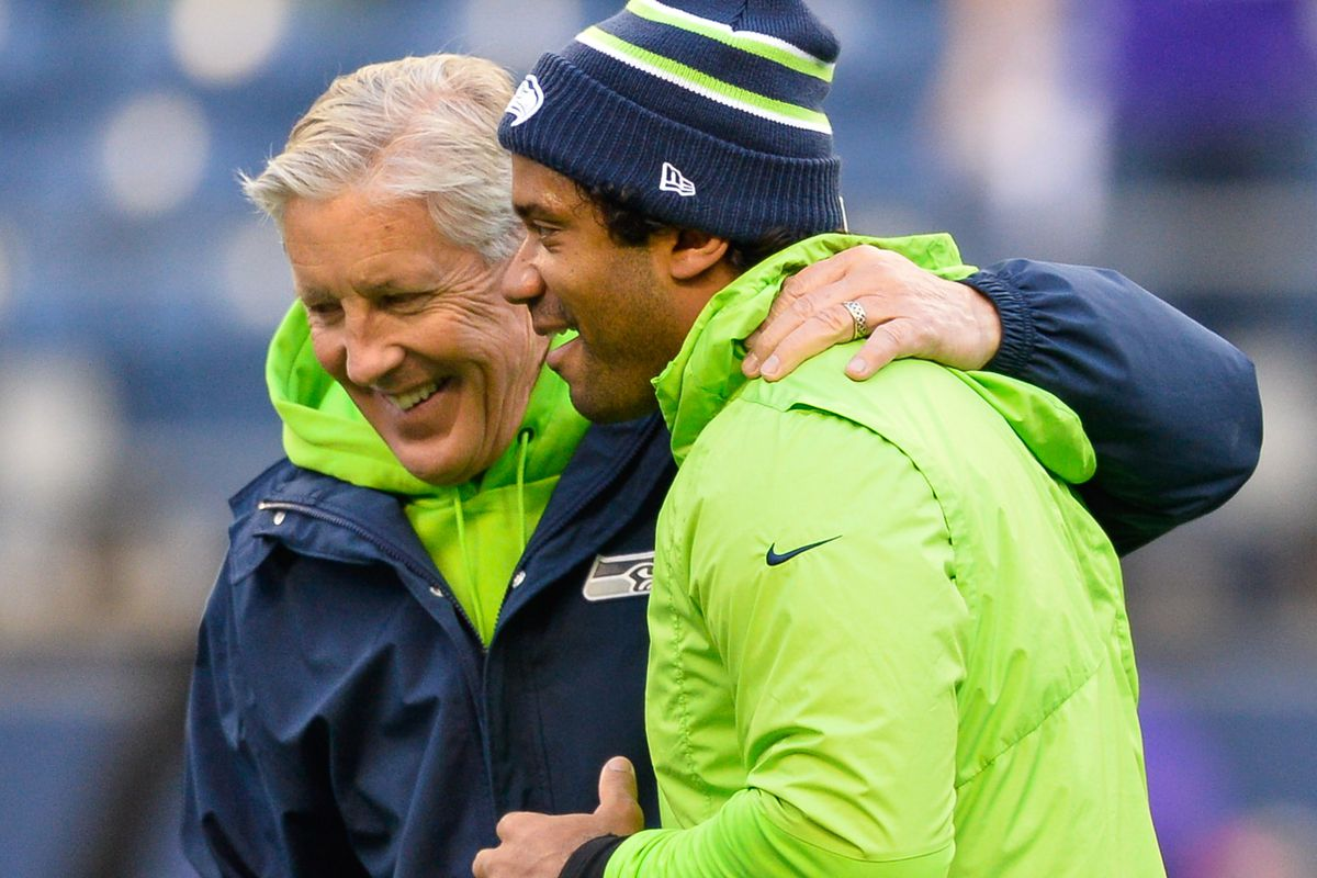 Seattle Seahawks head coach Pete Carroll and Seattle Seahawks quarterback Russell Wilson talk during warmups before a game against the Minnesota Vikings at CenturyLink Field.
