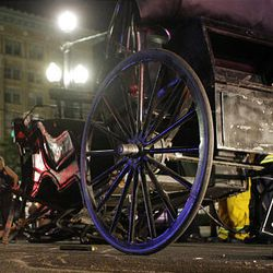 Emergency workers check out battered carriage after Saturday's wild ride.