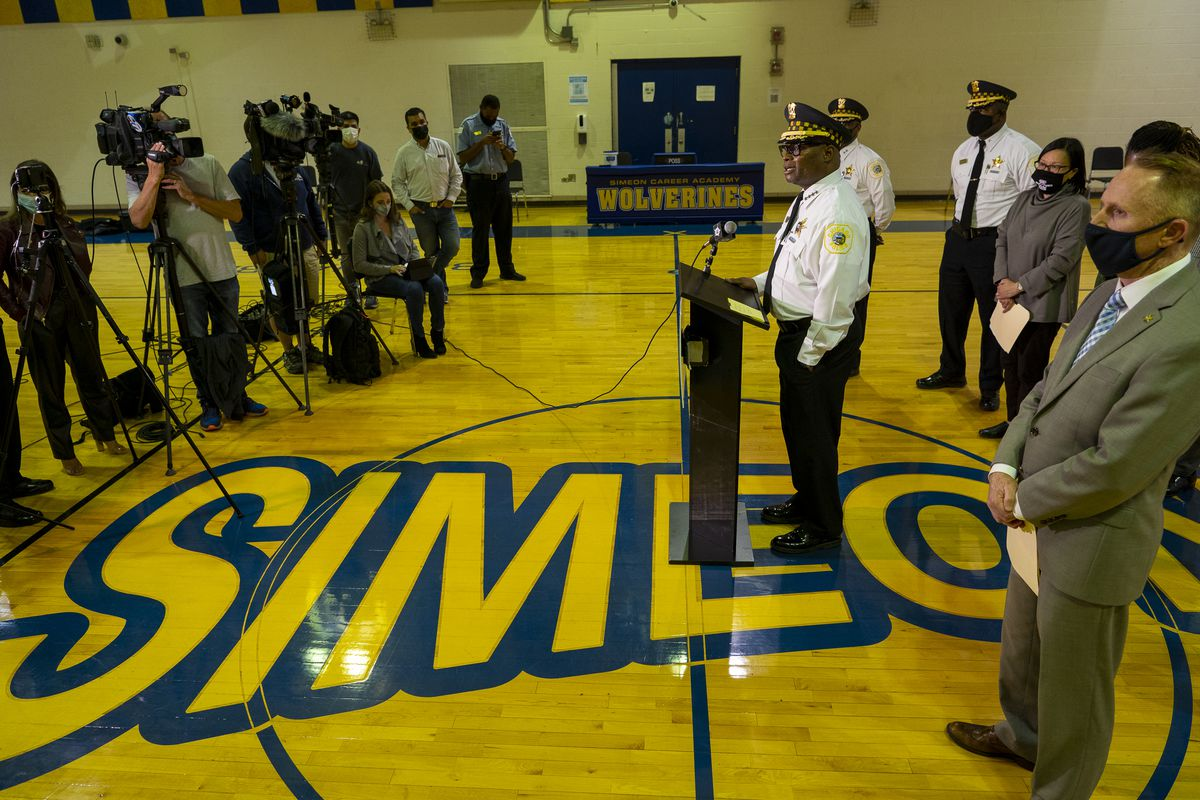 Chicago Police Supt. David Brown speaks to reporters in a gym at Simeon High School on Thursday over the shooting deaths of two students and a rash of threats Simeon and other Chicago Public Schools have received.