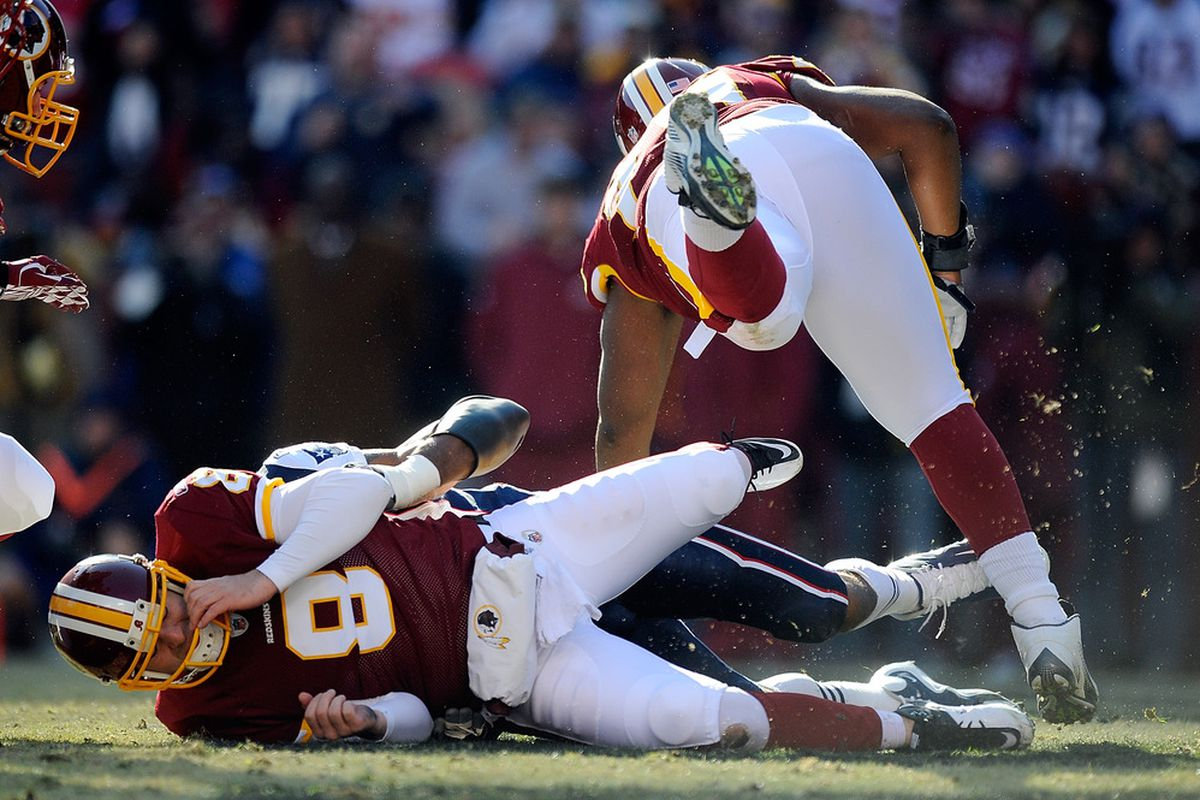 LANDOVER, MD - DECEMBER 11:   Rex Grossman #8 of the Washington Redskins fumbles the ball after being sacked by the New England Patriots at FedExField on December 11, 2011 in Landover, Maryland.  (Photo by Patrick McDermott/Getty Images)