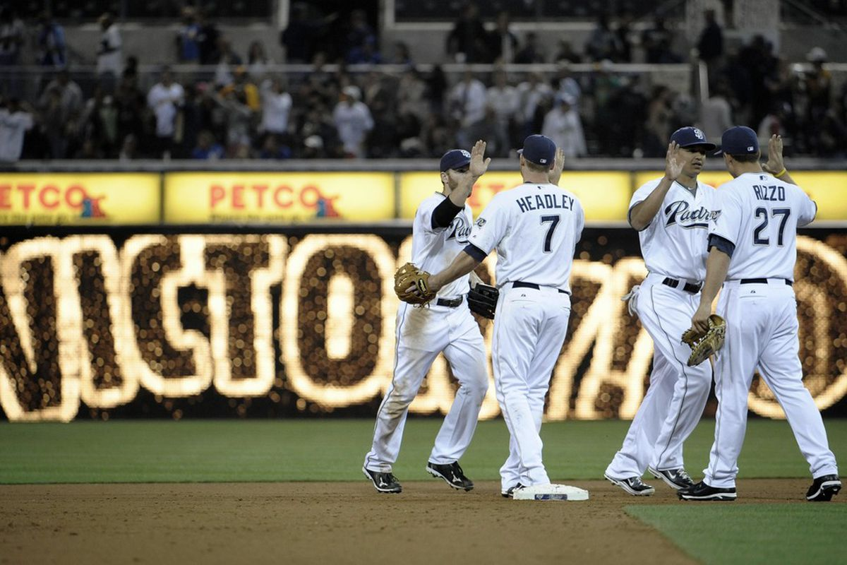 SAN DIEGO, CA - JUNE 27:  San Diego Padres players high-five after beating Kansas City Royals in a baseball game at Petco Park on June 27, 2011 in San Diego, California.  The Padres won 4-3.  (Photo by Denis Poroy/Getty Images)
