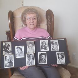Betty Nichols of Orem shows some of the autographed photo collection she recently donated to the SCERA Center for the Performing Arts.