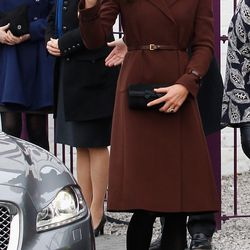 Arriving at Liverpool charity The Brink on February 14th, 2012 in a brown Hobbs coat.