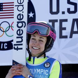 First-place finisher Sarah Hendrickson, center, stands on the podium following the women's ski jumping event at the U.S. Olympic Team Trials, Sunday, Dec. 31, 2017, in Park City, Utah. Hendrickson qualified for the Olympic team.