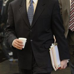 Lead prosecutor James McKay walks to court at the Cook County Criminal Court on the first day of the murder trial of William Balfour in Chicago, Monday, April 23, 2012. Balfour is charged in the 2008 murder of Oscar winning actress and singer Jennifer Hudson's mother, brother and nephew.
