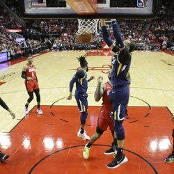 Utah Jazz center Rudy Gobert dunks during the first half of an NBA basketball game against the Houston Rockets, Sunday, Feb. 9, 2020, in Houston.