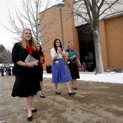 Missionaries leave the Christmas Morning Devotional at the Missionary Training Center in Provo on Tuesday, Dec. 25, 2012.
