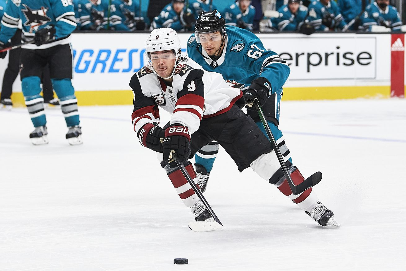 Arizona Coyotes right wing Clayton Keller (9) keeps the puck away from San Jose Sharks right wing Kevin Labanc (62) during the San Jose Sharks game versus the Arizona Coyotes on May 8, 2021, at SAP Center at San Jose in San Jose, CA.