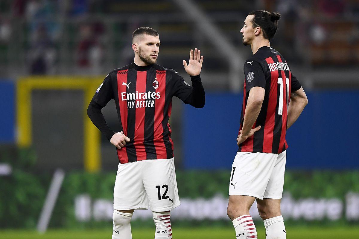 Ante Rebic (L) of AC Milan speaks with Zlatan Ibrahimovic of...
