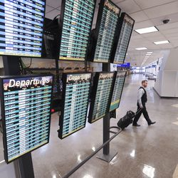 An airline employee walks through the Salt Lake City International Airport after a 5.7 magnitudeearthquakecentered in Magna caused the airport to be evacuated and closed on Wednesday, March 18, 2020.