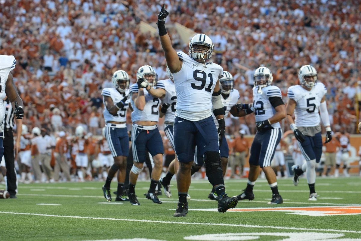 Travis Tuiloma celebrates after a play against Texas.