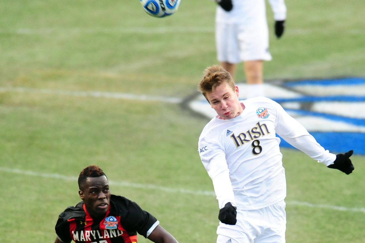 Besler flies for a header over Schillo Tshuma during the 2013 NCAA Championship game.