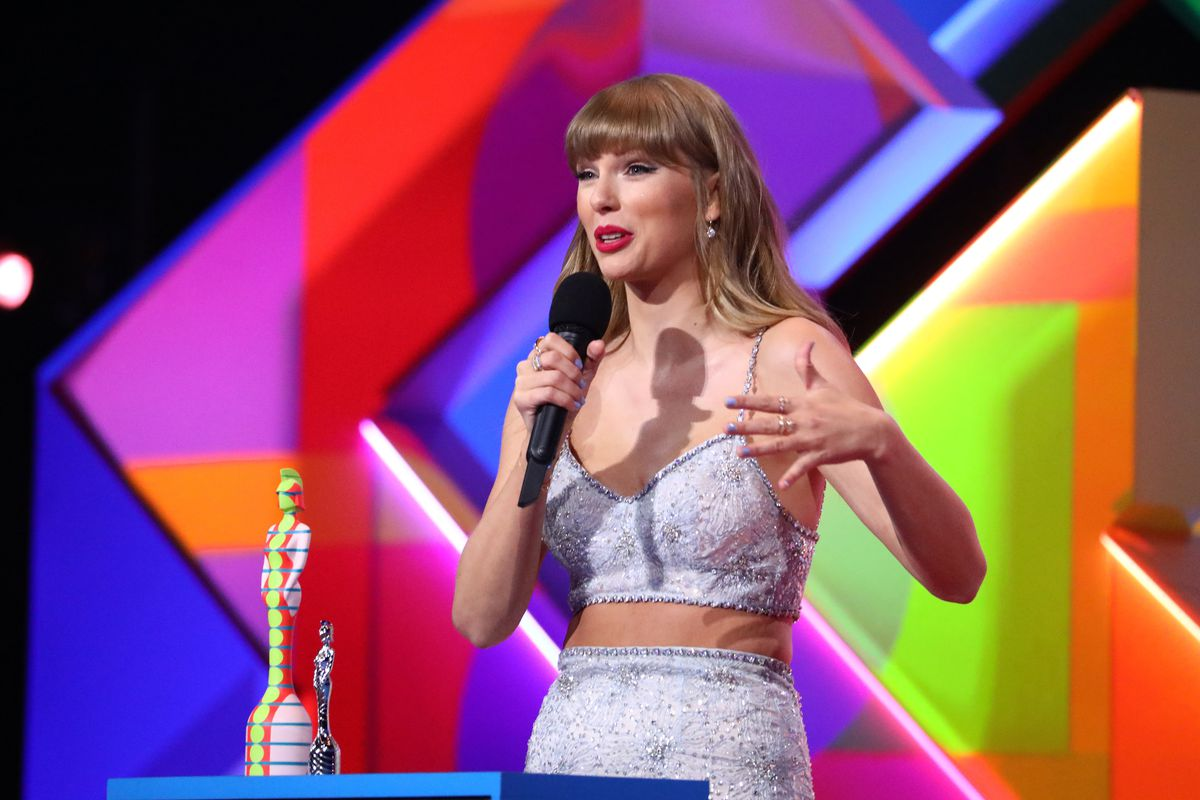 Taylor Swift speaks at the BRIT Awards 2021 Show.