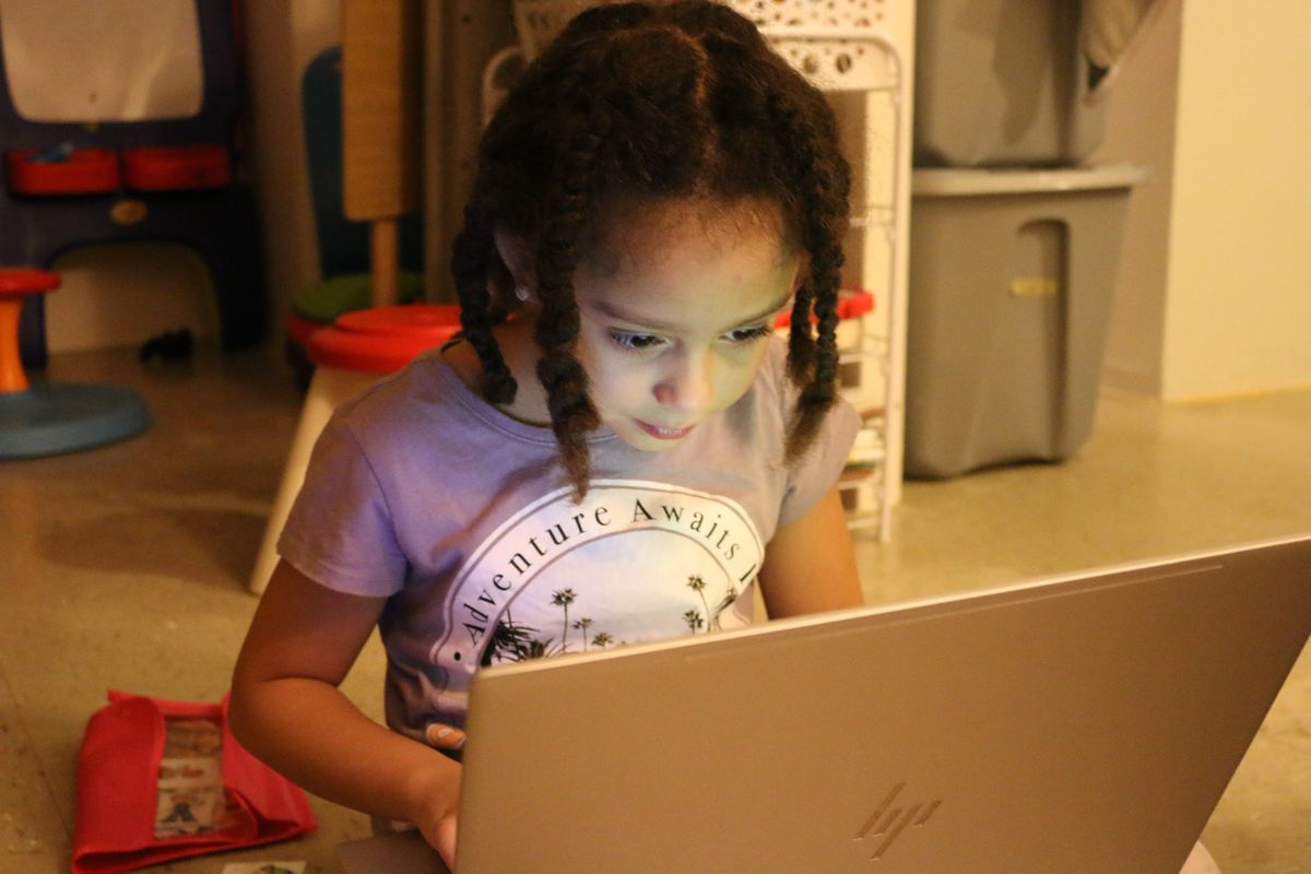 Jazmiah Vasquez, who has been out of school since 2017, plays a computer game at home.