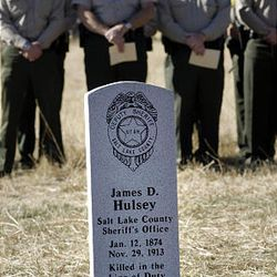 Salt Lake County Sheriff's deputies take part in a headstone dedication Monday for deputy James D. Hulsey, who was killed in the line of duty in 1913. The ceremony was held in the Bingham City Cemetery.