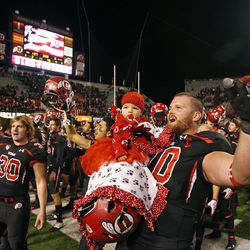 Utah Utes offensive linesman Tony Bergstrom (70) and daughter celebrate with the team after the University of Utah defeats Oregon State University 27-8 to win their first  conference  PAC12 football game Saturday, Oct. 29, 2011, in Salt Lake City, Utah.  (Tom Smart, Deseret News)