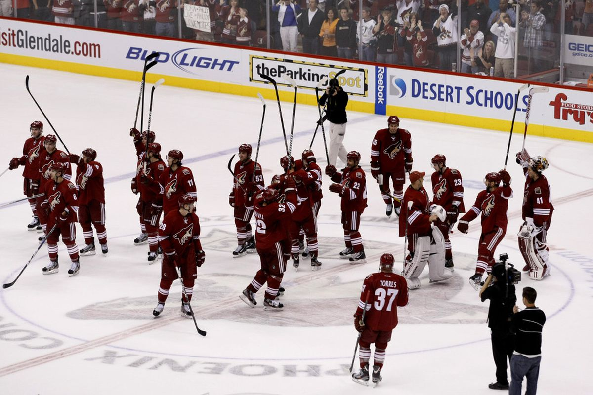 March 31, 2012; Glendale, AZ, USA; The Phoenix Coyotes acknowledge the fans after a game with the Anaheim Ducks in the third period at Jobing.com. The Coyotes defeated the Ducks 4-0. Mandatory Credit: Rick Scuteri-US PRESSWIRE
