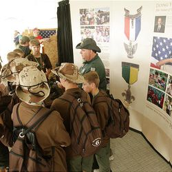 Tom Cole of LDS Relationships talks with Scouts about the George Albert Smith medal at the LDS Church Exhibit at the National Scout Jamboree at Fort AP Hill in Virginia Tuesday. Scouts from Utah are attending the event.