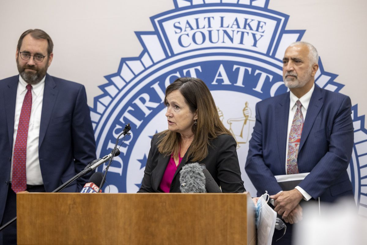 Utah County Attorney David Leavitt, left, and Salt Lake County District Attorney Sim Gill, right, listen as Summit County Attorney Margaret Olsondiscusses the death penalty in Utah at the Salt Lake County District Attorney's Office building in Salt Lake City on Tuesday, Sept. 14, 2021, as Utah County Attorney David Leavitt looks on.