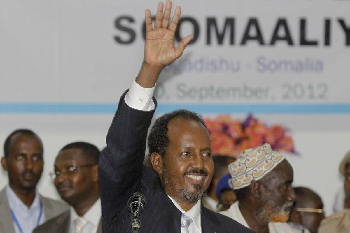 Somalia's new president Hassan Sheikh Mohamud, a political newcomer, speaks at a ceremony after being elected by the Parliament over outgoing President Sheik Sharif Sheikh Ahmed who conceded defeat, in Mogadishu, Somalia Monday, Sept. 10, 2012. Somalia's