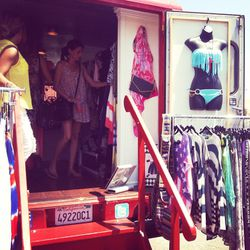 Shoppers perusing JD's fashion truck.