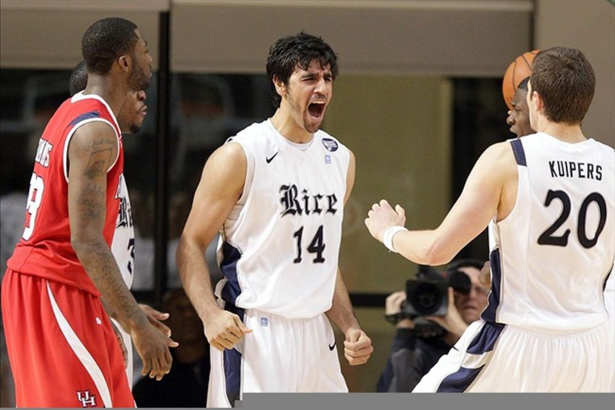 March 03, 2012; Houston, TX, USA; Rice Owls forward Arsalan Kazemi (14) reacts after scoring a basket in the second half against the Houston Cougars at Tudor Fieldhouse. Mandatory Credit: Troy Taormina-US PRESSWIRE