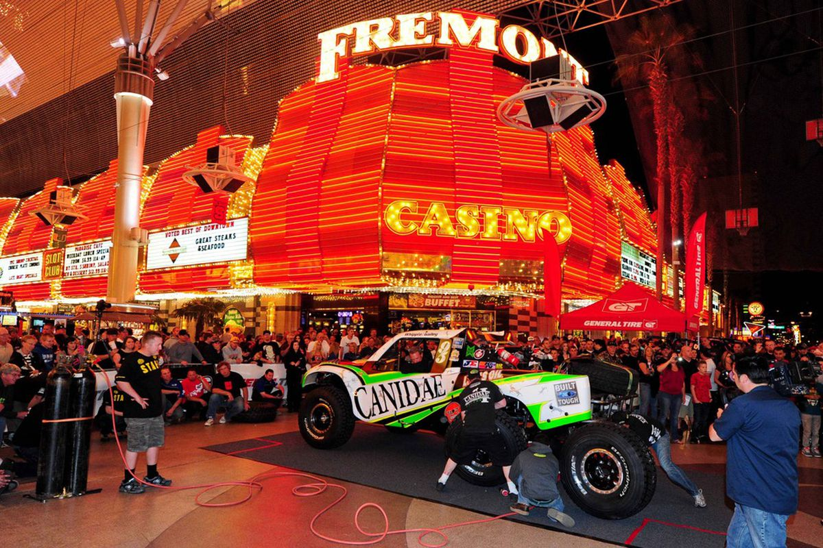 Mar. 21, 2012; Las Vegas, NV, USA; The crew of BITD trick truck driver Scott Whipple change 39 inch tires under the Fremont Street Experience during the pit crew challenge at the general tire Mint 400. Mandatory Credit: Matt Kartozian-US PRESSWIRE