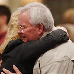 Brad Ator, father of crash victim Clark Ator, is comforted  on Thursday by a well-wisher at a vigil in Kirksville, Mo.