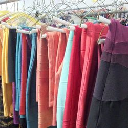 A rack of Herve Leger bandage dresses, all 75% off retail